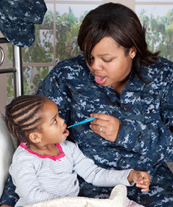 Image of Navy mother with child sick with appendicitis