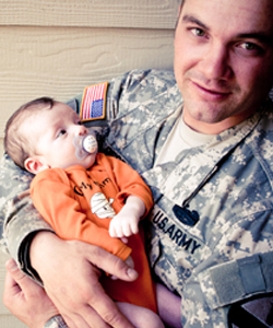 army-malpractice-dad-holding-baby