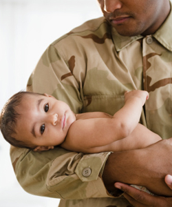 Image of Army father with sick baby meningitis